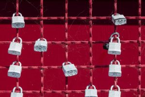 Photo of locks on a fence meant to signify the security of an ssl certificate